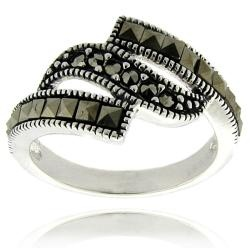 @Overstock - This is a beautiful wave design ring in silver overlay with an antiqued finish. This ring is adorned with marcasite gemstones.http://www.overstock.com/Jewelry-Watches/Silver-Overlay-Marcasite-Wave-Design-Ring/6780671/product.html?CID=214117 $10.99