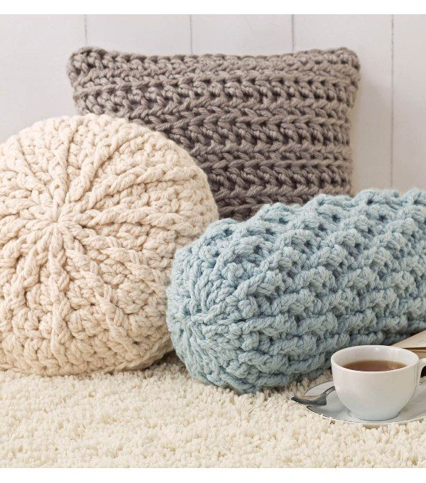 Replace your usual throw pillows in your living room with these interesting pillow patterns. It will add style and a warm personal touch to your home decor. These Cozy Crochet Pillows, courtesy of Simplicity, are worked with yarn held double. Round, square or neckroll, these pillows add comfort to any bed or sleeping surface. They are fast