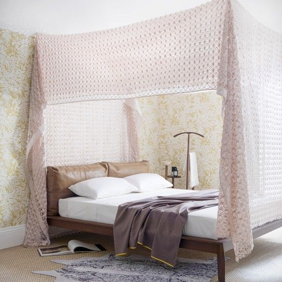 Pastel pink bedroom with bed canopy