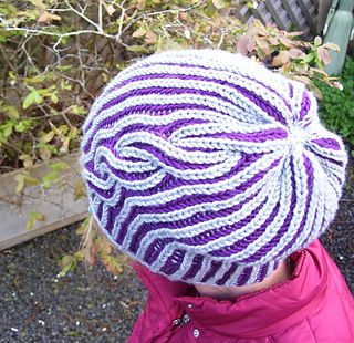 Now that we're confident with the Brioche Basic Beanie, let's try Brioche with a cable! If finished neatly, this cap will be very reversible giving the recipient options and highlighting the brilliance of Brioche. This may be considered an intermediate level pattern because knowledge of stitch construction, and research about Brioche is helpful.