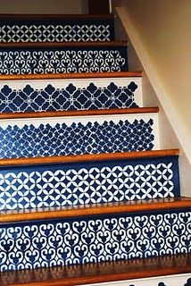 stenciled stairs, best stair decorations I've seen. They look like woven coverlets