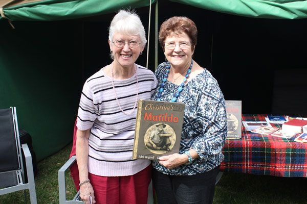 Edel Wignell with book buyer, Heather Byers, at the Clan Macpherson tent, Ringwood Highland Games, 1 April 2012.