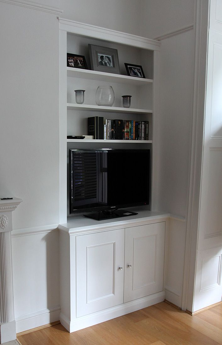 Classic style fitted alcove bookcase with cupboard