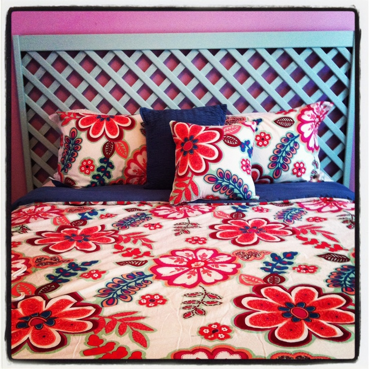 Homemade headboard using a part of a fence and paint