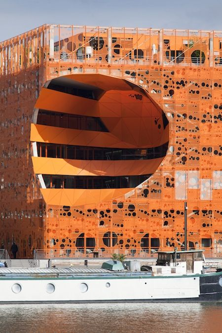 Orange Cube, Lyon, built designed by Jakob+MacFarlane. #architecture The city of the future, Lyon is the site of an important urban-renovation. Orange Cube built by Jakob+MacFarlane, is a sculptural volume. Its orange metal mesh color was inspired by the color of minium, red lead, an oxidation product of other lead minerals.