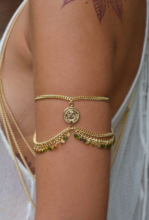 http://rubies.work/0954-ruby-pendant/ http://www.fashiontrendstoday.com/category/gold-chain/ Ruby Arm Cuff - Gold