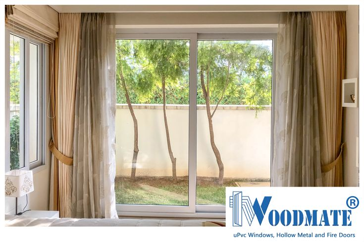 Some classy curtains, a little garden and sliding #uPVCWindows to take you there. Add #WoodMateWindows to your homes.  #Bedroom #uPVCWindows #upvcdoors  #upvcdoorsandwindows #Doors #windows #beautifulwindows #beautifuldoors #Beautifulhomes #interiors #architecture #Bangalore #DeccanWoodMate
