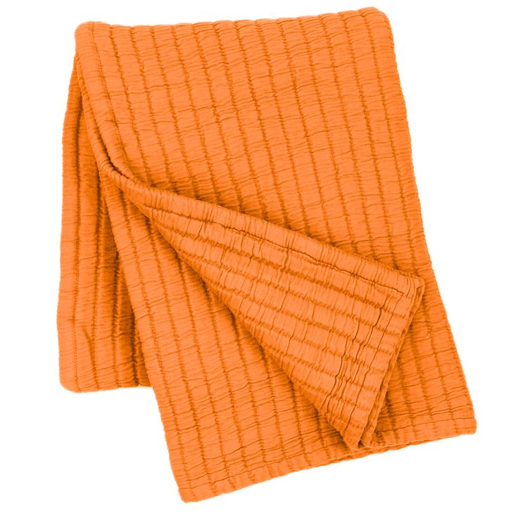 """You asked for it, and we couldnt help but deliver! Introducing our coziest cotton matelassé yet, now in a portable, 50"""" x 70"""" throw! In a happy, bright orange hue, this ultra-soft cotton matelassé throw can be draped over the foot of the bed for an extra layer of warmth, or tossed over a chair or couch for an instant style upgrade.   • 100% cotton.  • 1"""" hem/flange.  • Made in Portugal."""