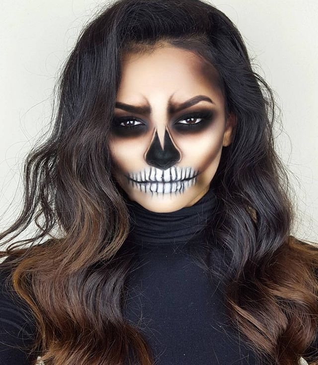 "Smokey eye sockets and subtle white background might be more wearable. Leaving the eyebrows out of the smokey eye is less skeleton like, but allows for ""angry eyes"""