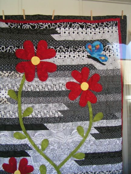 """Jelly roll race quilt. Flowers are 6"""" hearts"""