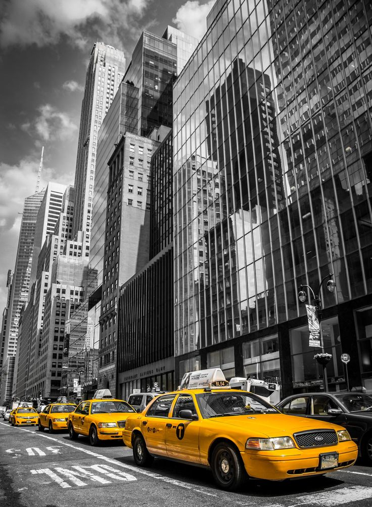 A number of Yellow Taxis shadowed by Skyscrapers