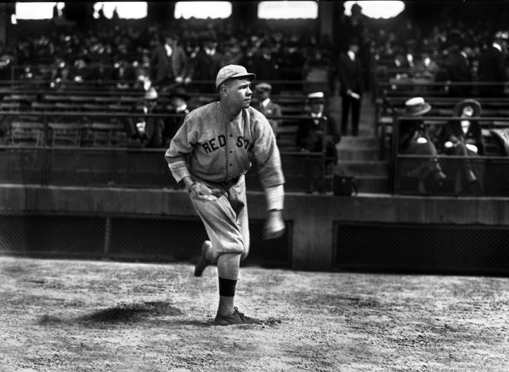"""BABE RUTH WARMING UP """"at Wrigley Field"""" (1918) is the caption sometimes seen. The Chicago national league park was not known as Wrigley Field in 1918. It was named Weeghman Park after the team's owner.  In any case, in facing the Red Sox in Chicago, the Cubs used Comiskey Park in the 1918 World Series. The South Side ballpark (of the White Sox) had a larger capacity than Weeghman Field."""