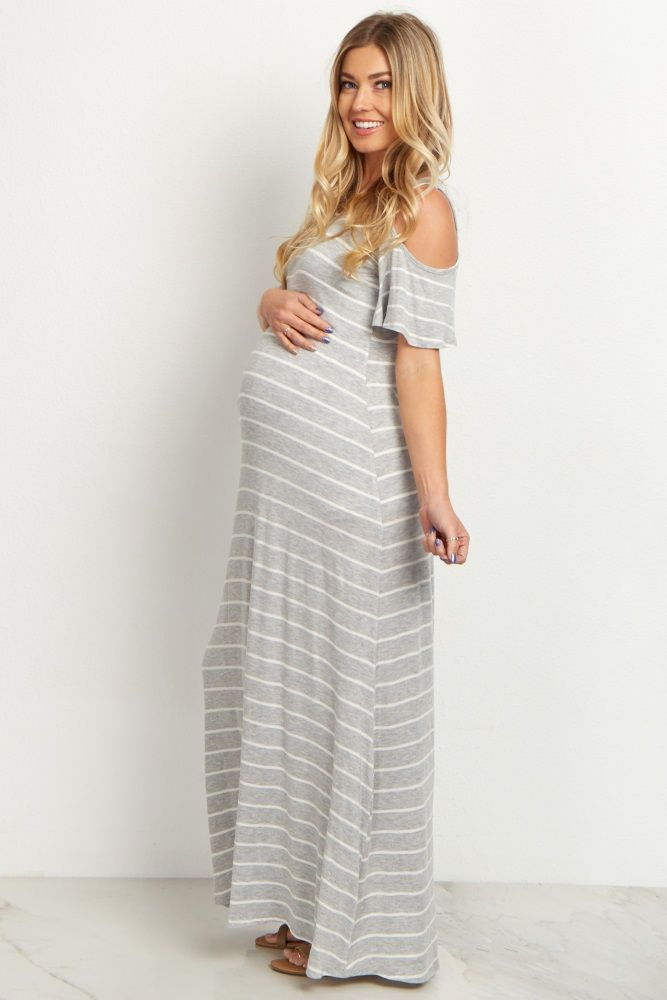 A classic striped print for a chic maternity maxi dress you can style up or down for any occasion. A cold shoulder detail keeps you on trend as you show off your bump in this dress. Dress this piece up with wedges and a long necklace or keep it casual with sandals.