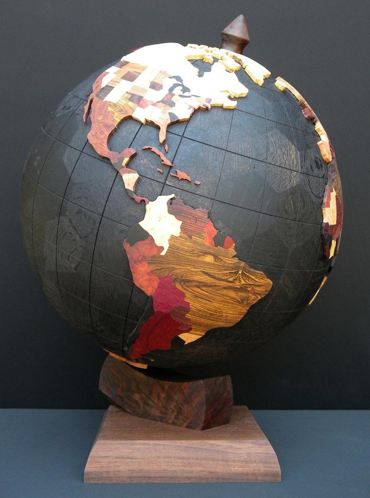 Steve Garrison - The World Globe: Various woods on ebonized oak base sphere, walnut base, steel axle