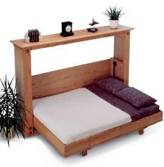 Fold-Down Bed, but with added folding table when bed is up. Now this solves the problem of what furniture you can put in a tiny house for ultimate space usage!