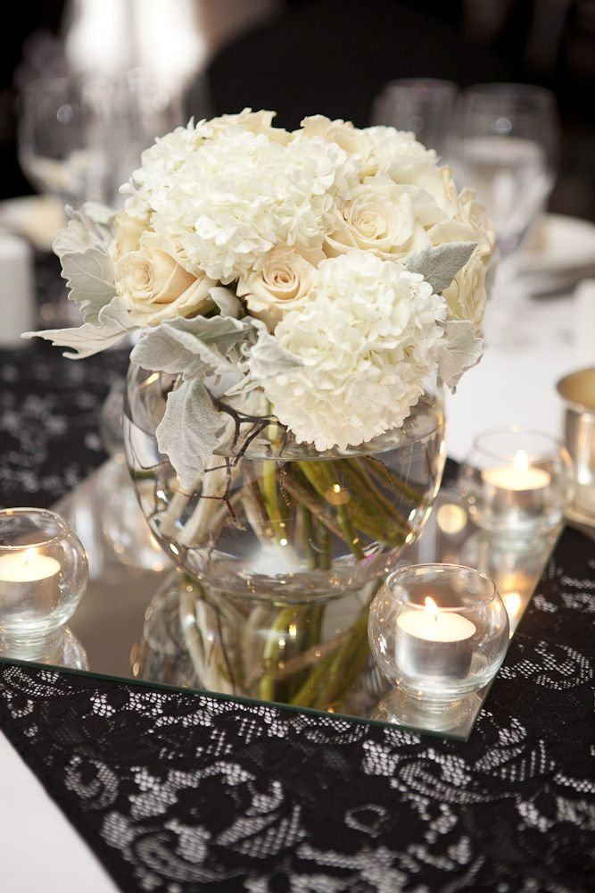 Black lace runner with white floral centrepiece. Styled by Greenstone Events.
