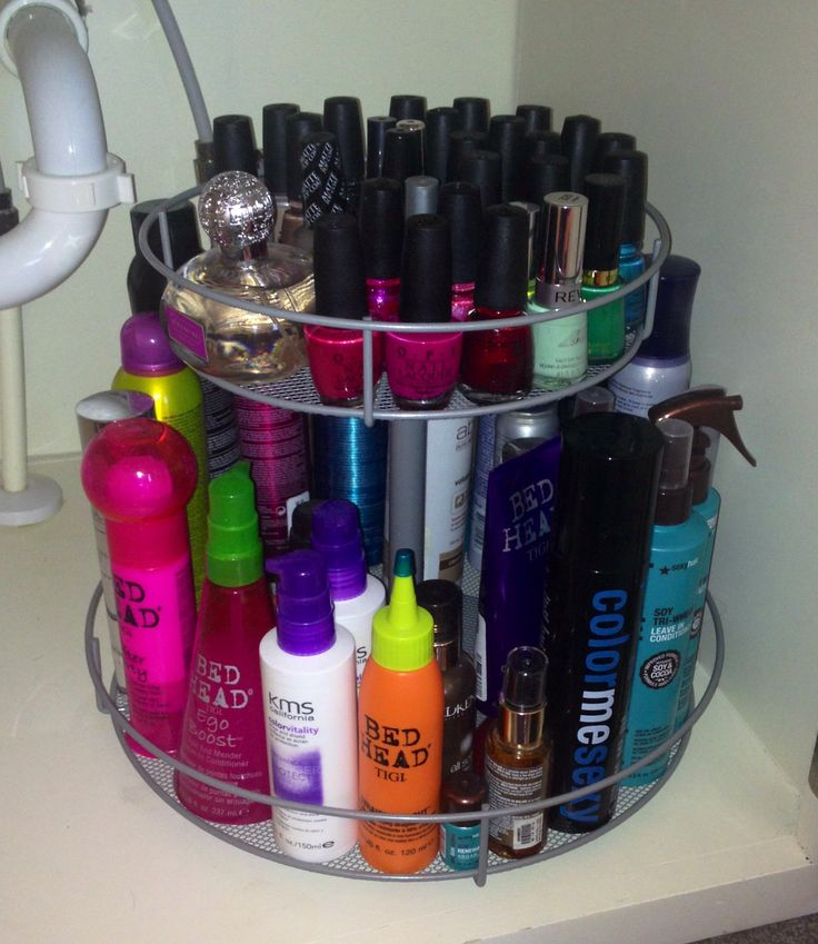 Bathroom organization: spinning organizer from Bed, Bath and Beyond. Fits perfectly in the cabinet under my sink and holds all my hair products, perfume, and nail polish!