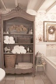 repurpose an old china cabinet as a bath towel closet (could also work at the front door?)