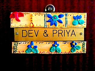 Name plates with cold porcelain designs
