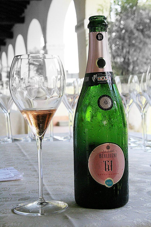 Tasting Berlucchi 61 rosé in the patio of Palazzo Lana, Berlucchi winery in Franciacorta, Italy