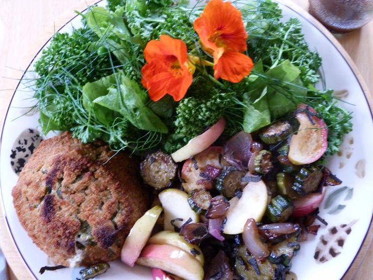 From Plot to Plate~garden fresh salad with peppery nasturtium flowers and fried courgettes, apples, and onions with sage butter