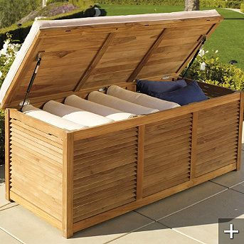 Louvered Teak Truck For Outdoor Storage.