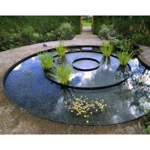 still water feature, water element, landscape art, landscape architecture, water plants