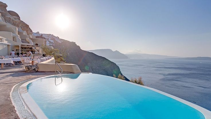 Mystique A Luxury Collection Hotel Santorini Oía Located On Oia S Most Famous Cliffs Features An Infinity Pool With Sun Deck And Bar