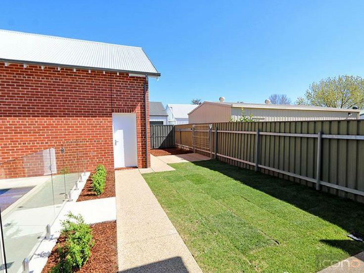 Clean cut outdoor area! #Australianhomes #outdoorarea #grass #garden