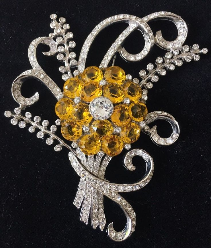 """Marked """"Coro"""" on the reverse. Yellow multi-faceted unfoiled stones with rhinestones forming a spectacular flower spray of rhodium plated alloy metal. See photos.   eBay!"""