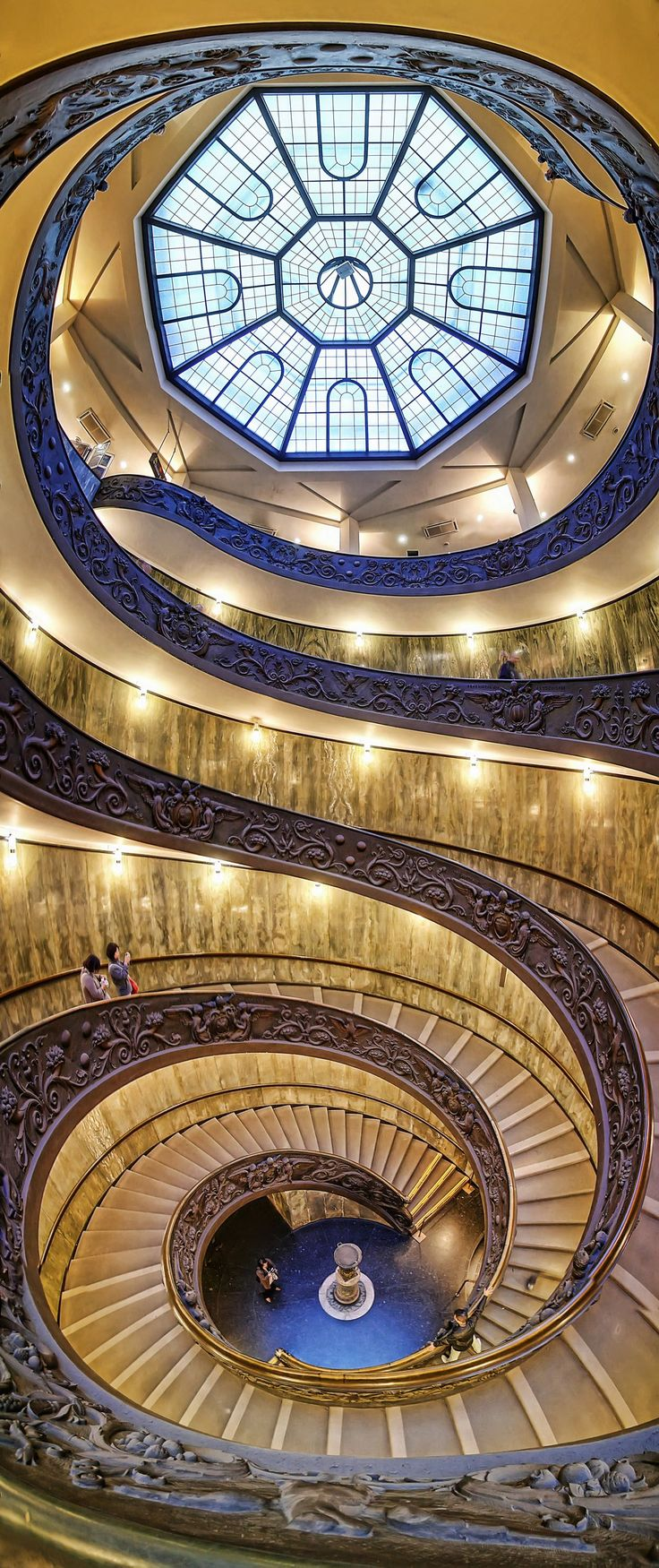 Spiral staircase at the Vatican Museum. Photo by Silvio Zangarini http://www.eduardplanting.com/artists/zangarini-silvio/stairs-zangarini/spiral-vatican-museum.html