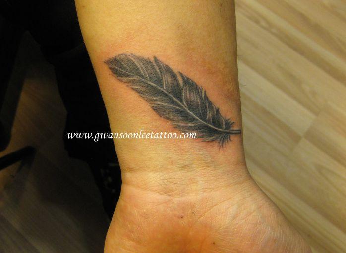 feather tattoos | Feather tattoo on wrist