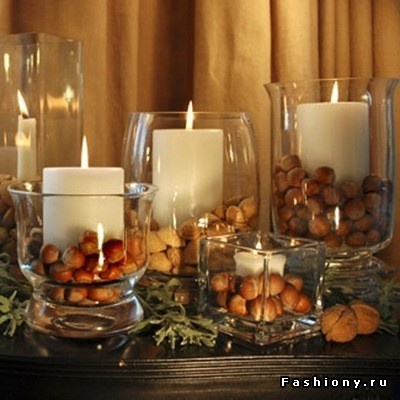 Easy but pretty, Glass wide mouthed bases/candle holders, fill base with nuts and place candle in center!