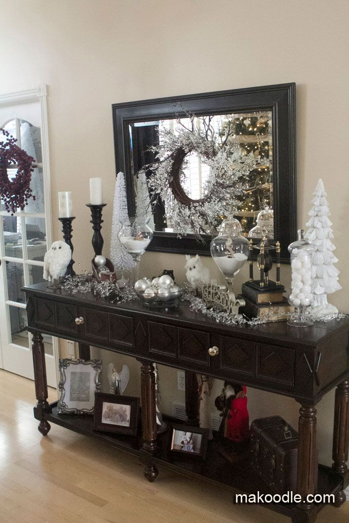 "Christmas Decor for entryway table ~ large candlesticks, flocked white trees, glass jars filled with ""snow"""