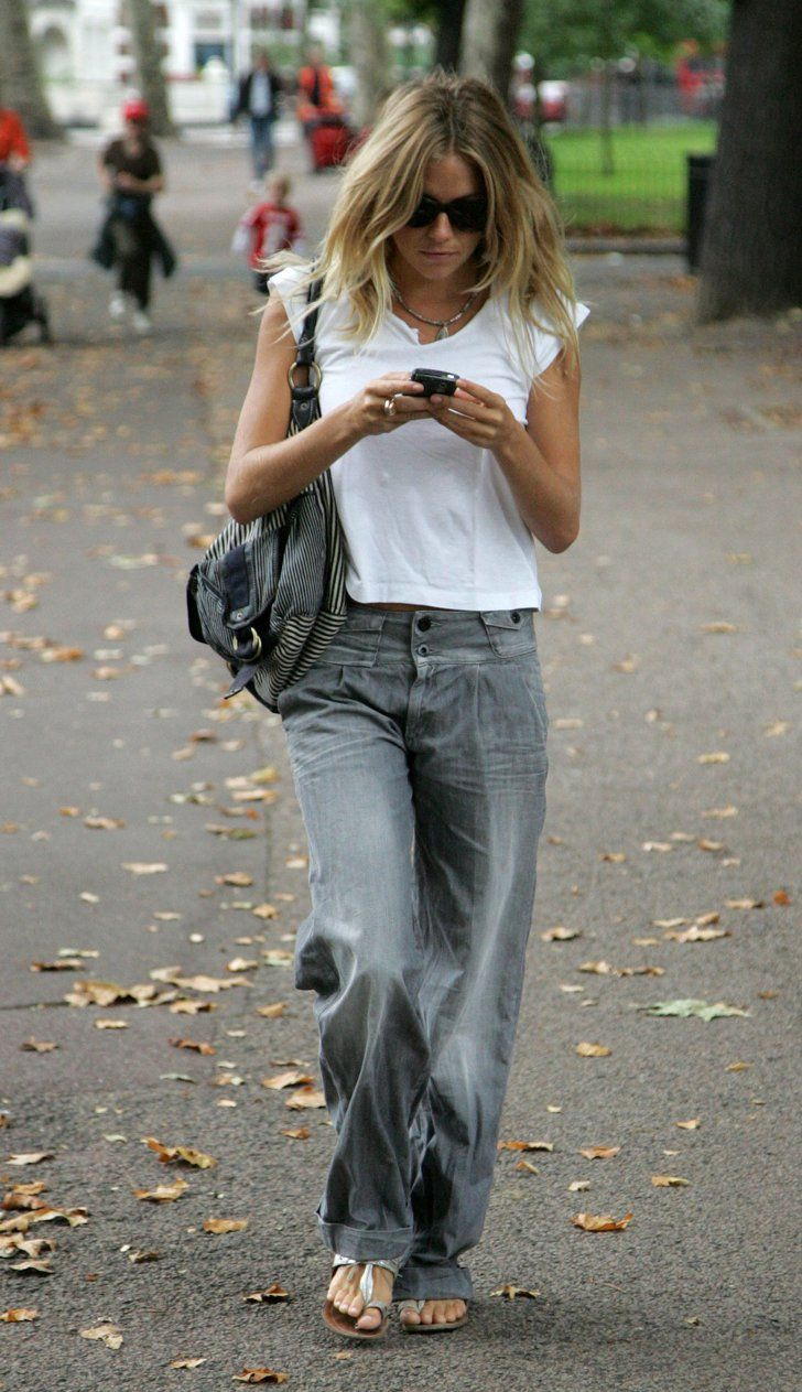 Pin for Later: 14 Style Icons Who Make Jeans and a White Tee All Their Own Sienna Miller Accessorise with a hobo bag and easy, t-strap sandals.