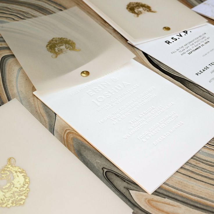 golden wedding invitations%0A Twist rotating wedding invitation suite  gold foil logo on vellum cover   blind emboss