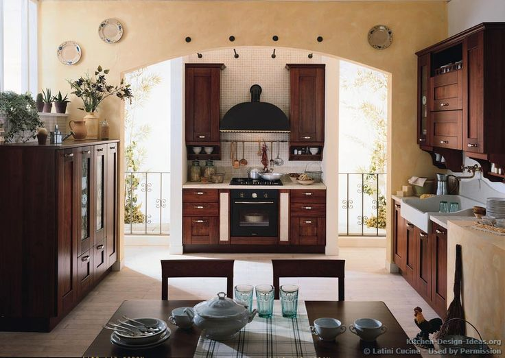 Idea Of The Day: A Warm Tuscany Kitchen With Rich Wood Cabinetry, A  Venetian Plaster Archway, And Dark Metal Range Hood. Very Good, Dark Wood  Golden Brown ...
