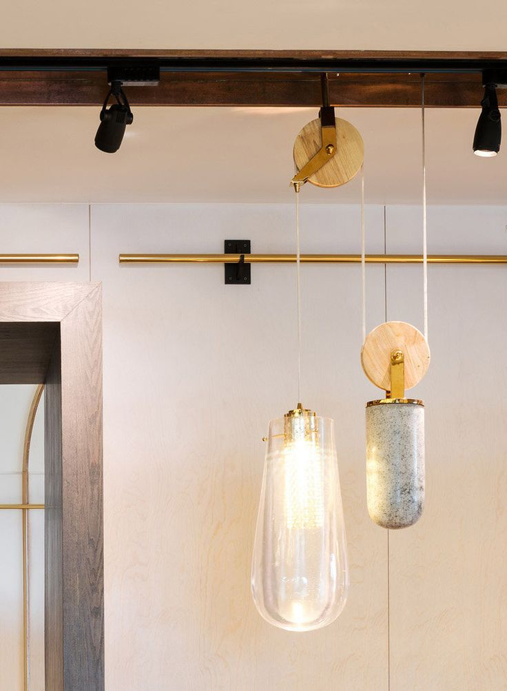 Interior Design Details - Industrial Close Ups // These pendant lights hanging from a modern pulley system put a contemporary spin on the traditional rustic look of the older pulley systems.