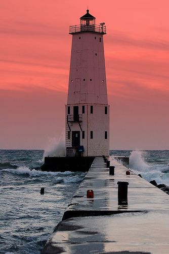Frankfort Lighthouse~Sunset on Lake Michigan, with 30mph winds and large waves crashing over the harbor wall, this was a spectactular sight to see and photograph.