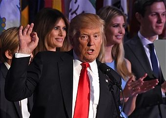 TOPSHOT - Republican presidential candidate Donald Trump flanked by members of his family speaks to supporters during election night at the New York Hilton Midtown in New York on November 9, 2016. Trump won the US presidency. / AFP / Timothy A. CLARY