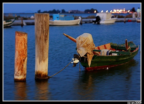 fish boat on the calm waters of the western canal of the town