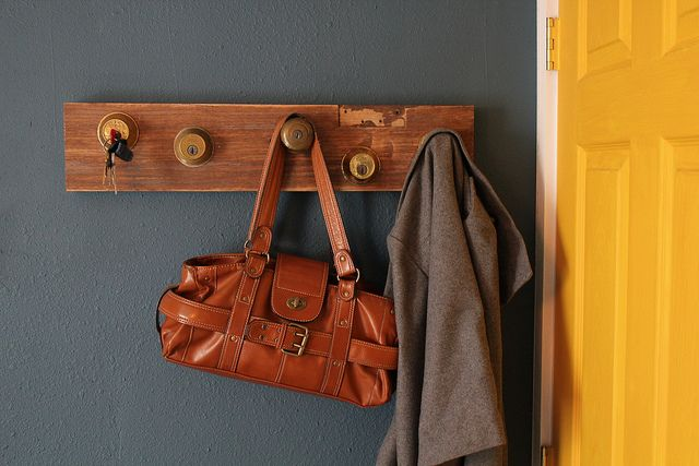 Key/purse/jacket holder using a block of wood and old door knobs/locks. I bet you could make this really adorable with fancy looking knobs...