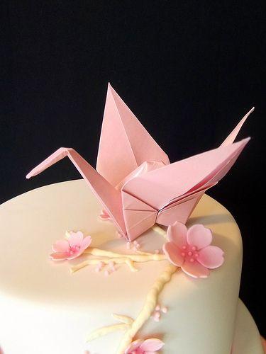 Paper Crane on a cake. It's classy and pretty.