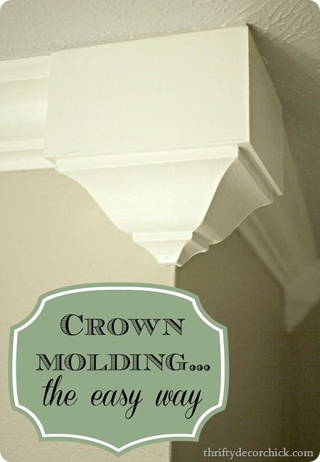 "easy crown molding using ""cheater pieces"" at the corners.  No mitering required.  http://thriftydecorchick.blogspot.com/2013/05/cheater-crown-molding.html"