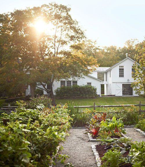 This upstate New York kitchen garden — composed of raised beds edged with Belgian block stone — yields a mix of edibles and cutting flowers. #gardening
