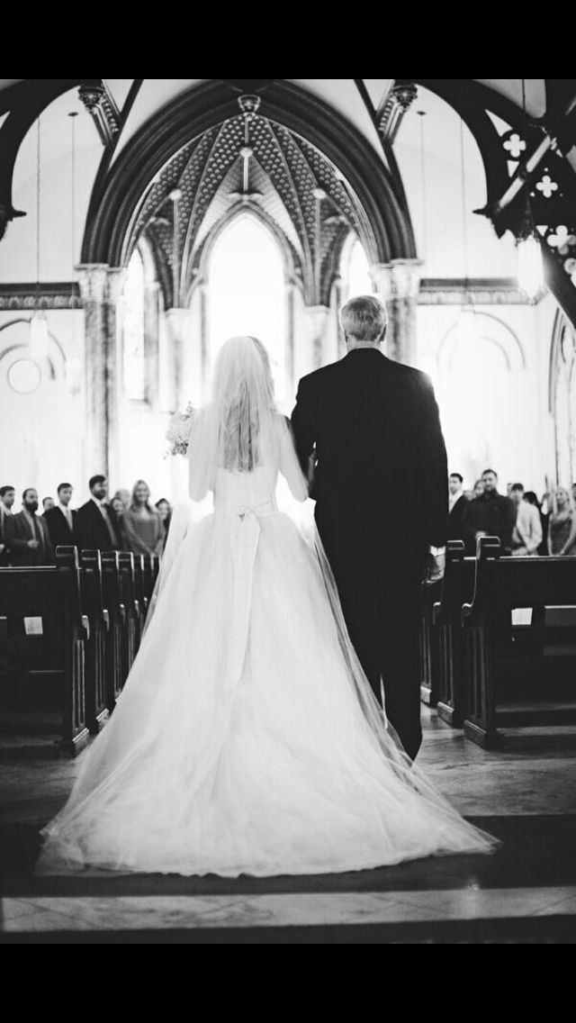 A picture that is barely taken. Bride & dad on the way to my husband to be. But would have to be my brother instead