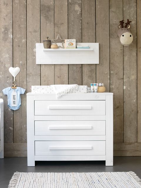 love the clean contrast in the rustic wood wall behind white nursery furniture