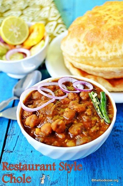 Restaurant style chole bhature - chickpeas / chole cooked in a spicy gravy usually served with bhature and super popular in North India.