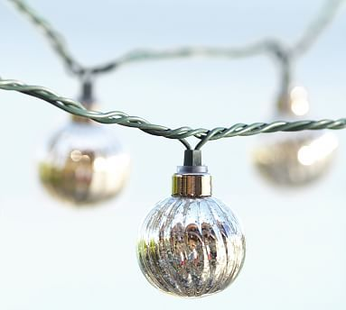 Mercury Glass Globe String Lights #potterybarn These lights make outdoor living more  beautiful. Especially in the summer and early autumn. y