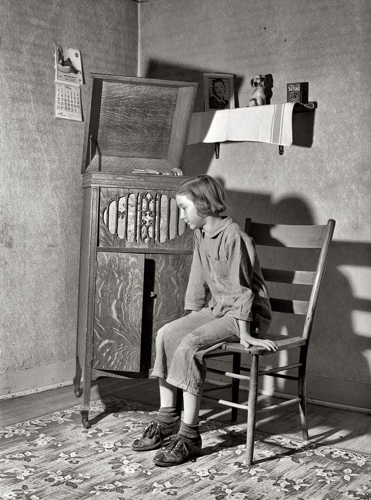"""May 1940. Crawford County, Illinois. """"Daughter of Farm Security Administration rehabilitation borrower listening to phonograph."""" Medium format safety negative by John Vachon"""
